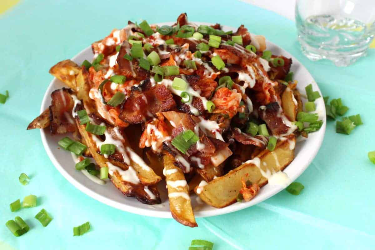 Spicy and flavorful, a must-try for dinner! Kimchi, a Korean side dish of fermented vegetables adds a flavourful punch to these fries!