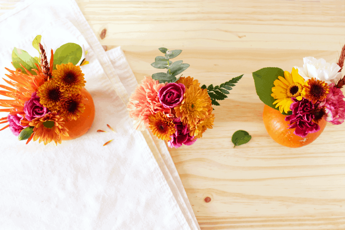 DIY mini pumpkin florals come in handy whether you're a guest or a hostess. You can bring these to a party as a hostess gift and if you're the host, create a beautiful table setting!