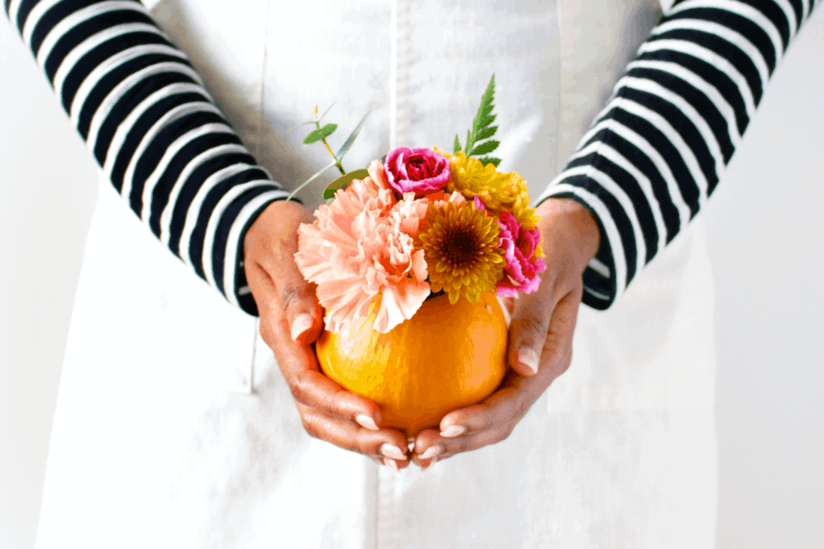 As soon as I saw mini pumpkins at the grocery store, I knew I had to make a DIY with them! I'm kinda obsessed with fresh flowers and miniature things so DIY mini pumpkin florals are pretty much the perfect combo. Now I don't usually decorate in orange like ever but I think it works really well in small doses like this. Right? In this case, the warm, small pop of orange adds a really cheerful touch that makes us love sweater weather even more!