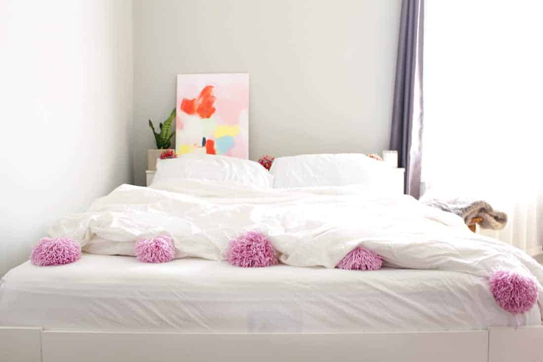 DIY Pom Pom Blanket on Brit + Co